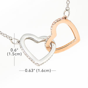 Two hearts embellished with Cubic Zirconia stones, *interlocked together* as a symbol of never-ending LOVE [LIMITED OFFER!]