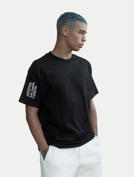 asystem black tee on male model