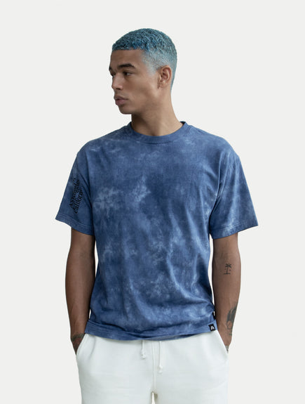 asystem tie die t-shirt on male model front