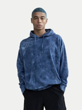 asystem blue tie die hoodie on model front facing