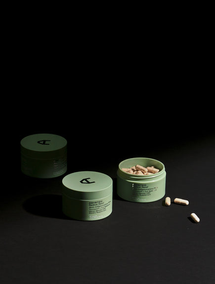 anti inflammatory pills container with black background