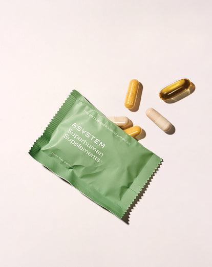 asystem supplements pills packet flat lay