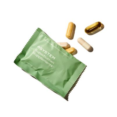 Green superhuman packet with pills spilling out of it