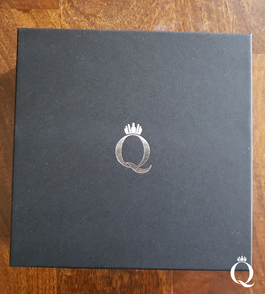Crown and headband packaging for The Queen of Quartz. Matte black box with metallic silver logo and velvet wrap