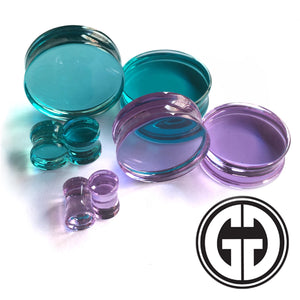 Double flared solid glass plugs