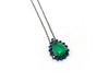 Emerald Faceted Drop Pendant with Blue Sapphire Bezel