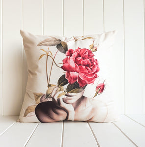 Stunning artistic feminine cushion featuring woman with red roses. White base. Home decor style