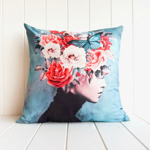 Beautiful cushion with artistic woman with flowers and butterflies in her hair. Interior style decor