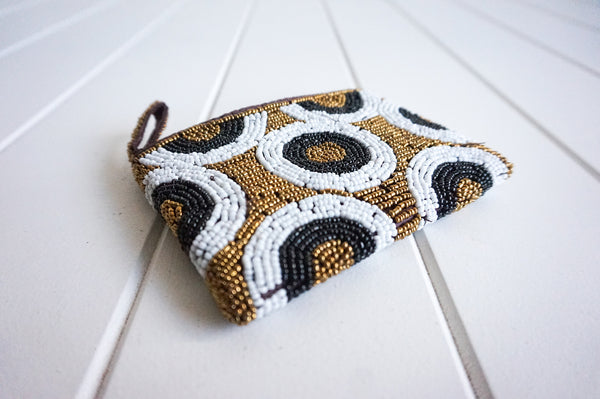 Beautiful quality, delicate and petite beaded coin purse Fits lipstick, cash, cards. Elegant.