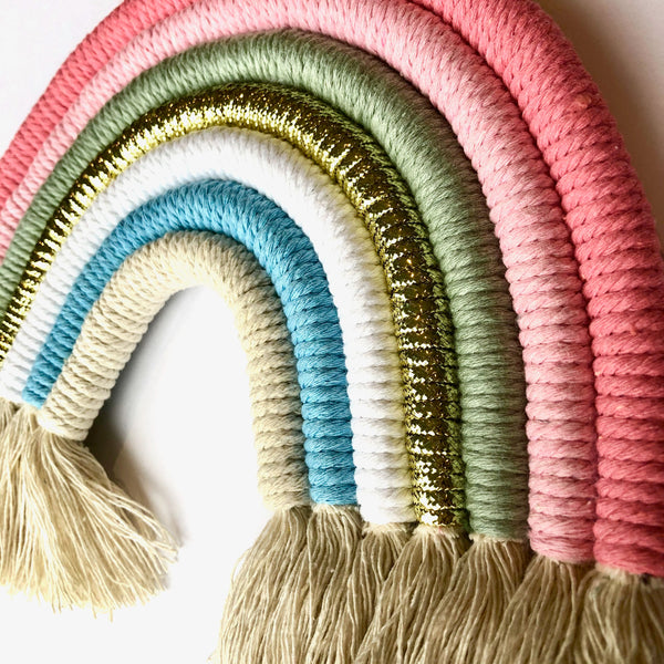 Hangin Woven Rainbow is soft pastel colours. Ideal wall decoration, easy to hang. With tassels.