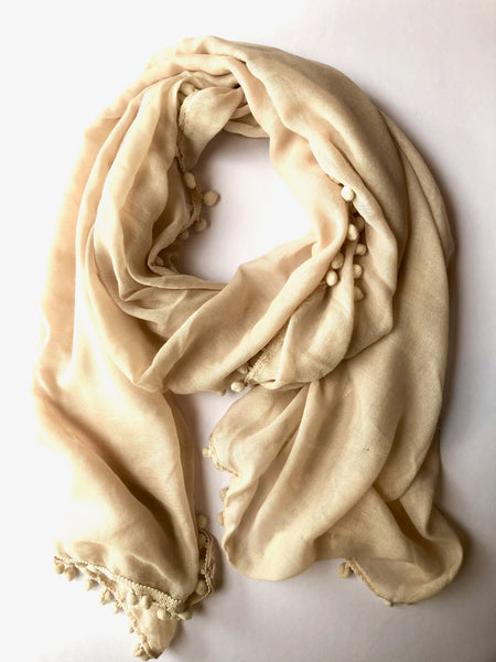 Beige Pom Pom Scarf.  A lovely cream beige colour. Perfect fashion accessory for any occasion. Fun