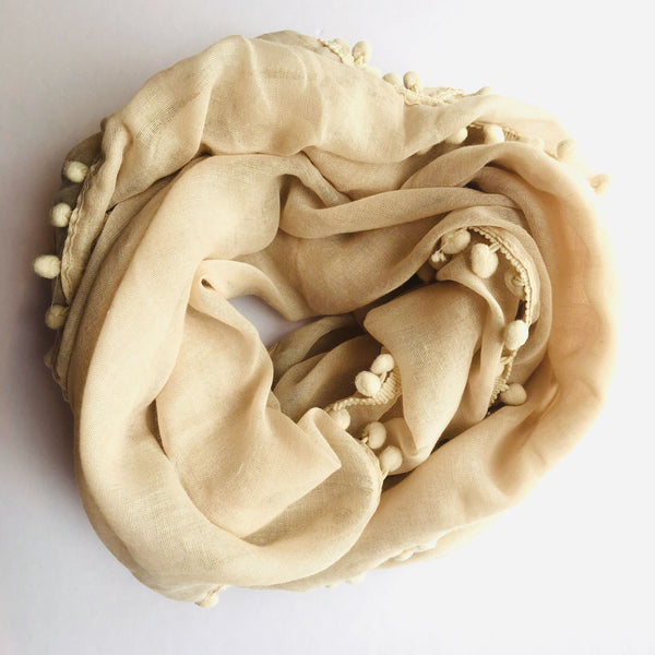 Beige Pom Pom Scarf. Light. Scarves available at Hello Bella Lifestyle Online Australia. Bargain