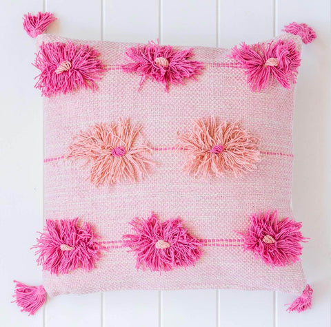 Pretty pink cushion with fun tassels and pompoms. Beautiful quality homewares and soft goods.