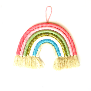 Beautiful woven hanging rainbow, with soft colours. Wall decor for a bedroom or hallway.