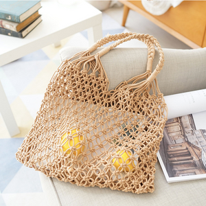Those woven cotton shopper bags come in beige or white, and good for the environment. So Stylish.