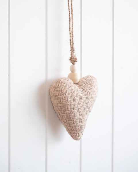 Interior stylists will love this hanging heart wall decor. Beautiful natural beige colour. Stylish