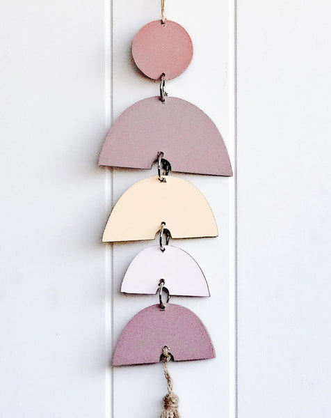 Hanging wall art featuring pink and neutral rainbows. Great gift idea and home decor styling. Fun