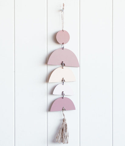 Hanging rainbow wall decor in blush pinks. Perfect for interior styling or a gift idea. So pretty