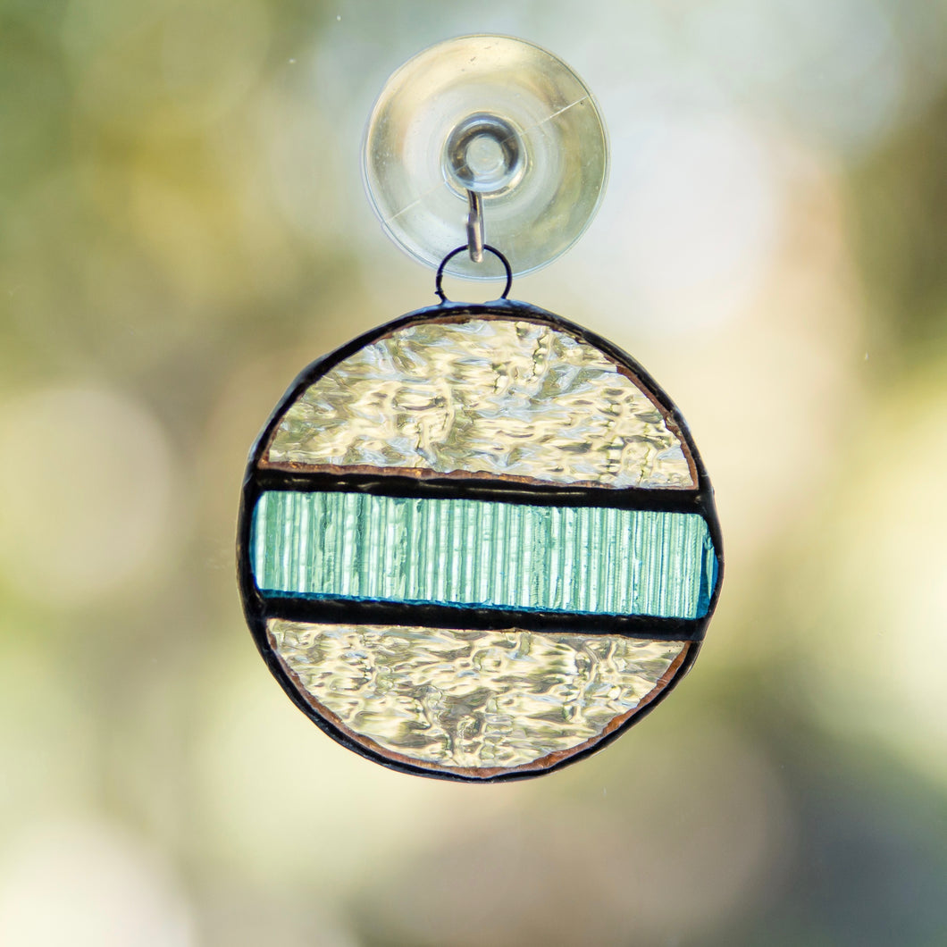 Stained glass clear snowball with the blue insert window hanging
