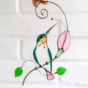 Sitting on the branch with pink flower hummingbird suncatcher of stained glass