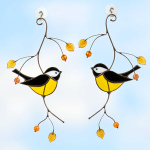 A pair of black chickadees on the branch with leaves and berries stained glass suncatcher