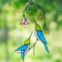 Load image into Gallery viewer, Pair of stained glass hummingbirds with a flower stained glass suncatcher