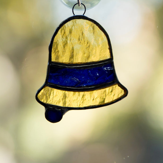 Stained glass yellow bell with a navy insert suncatcher for Christmas decor