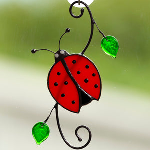Stained glass ladybug on the branch suncatcher