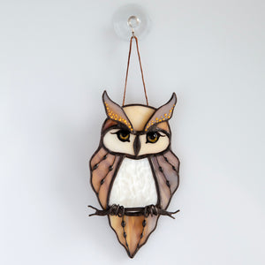 Stained glass horned owl sitting on the branch window hanging