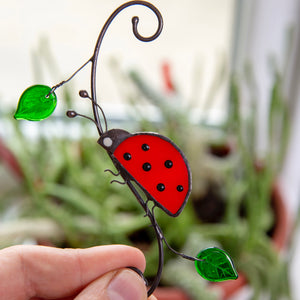Side-view red ladybug suncatcher of stained glass