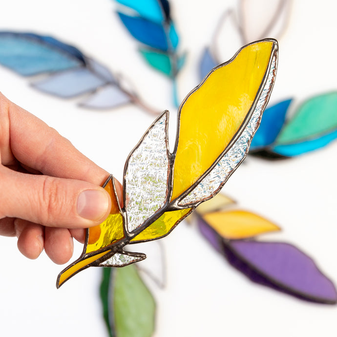 Stained glass yellow feather with clear parts suncatcher