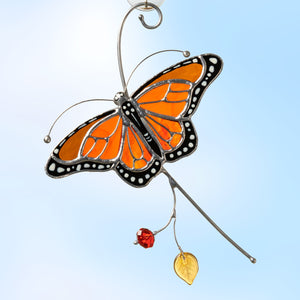 Stained glass flying on the branch monarch butterfly window hanging