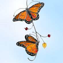 Load image into Gallery viewer, Bright orange monarch butterflies stained glass window suncatcher  Edit alt text