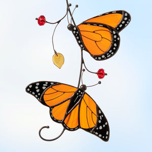 two monarch butterflies sitting on the branch stained glass suncatcher  Edit alt text