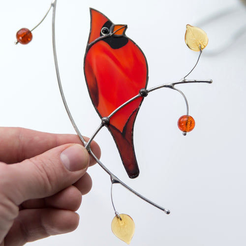 Zoomed stained glass redbird on the branch window hanging