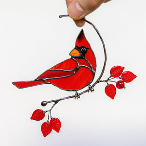 Redbird sitting on the branch stained glass window hanging