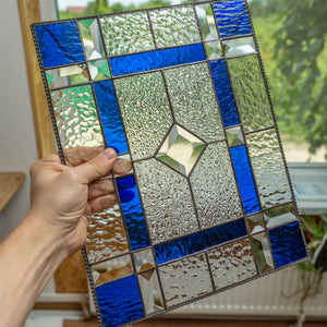 Stained glass clear panel with cobalt and beveled inserts