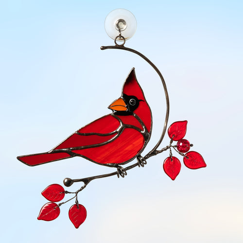 Stained glass male cardinal sitting on the branch with red leaves window hanging