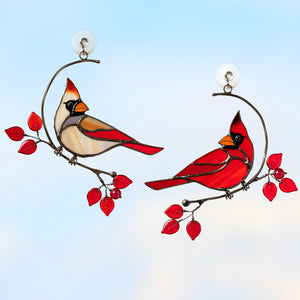 Stained glass cardinals: male and female sitting on the two separate wire branches with red leaves  Edit alt text