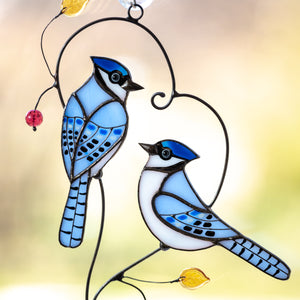 Zoomed stained glass suncatcher pf pair of bluejays