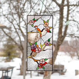 Stained glass cherry blossom and birds sitting on the branch panel