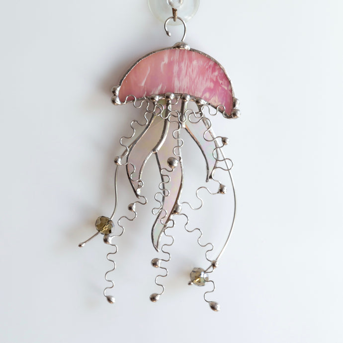 Stained glass pink jellyfish with iridescent tentacles suncatcher