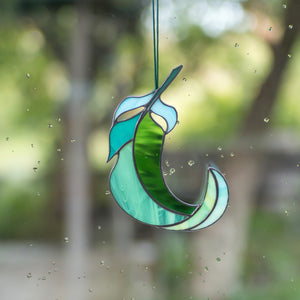 Green and its shades stained glass bending right feather suncatcher