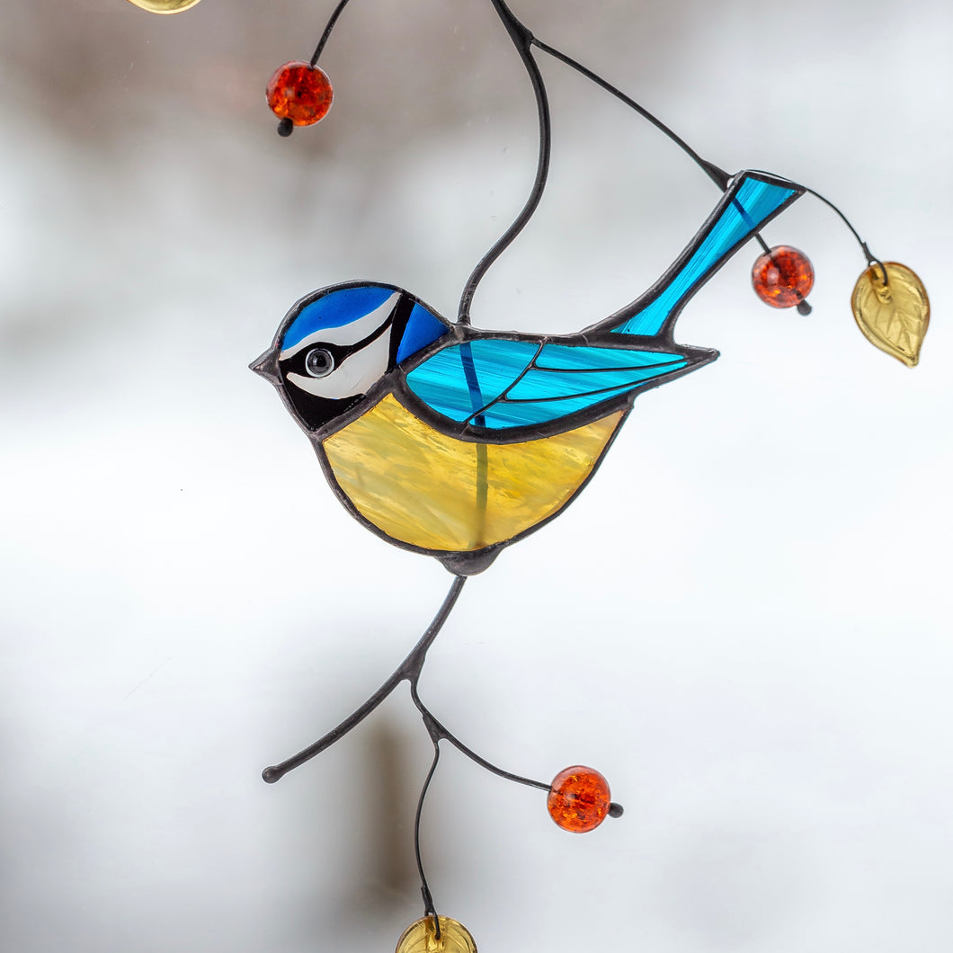 Stained glass blue chickadee on the branch window hanging