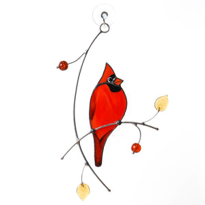 Stained glass window hanging of a Cardinal on the branch