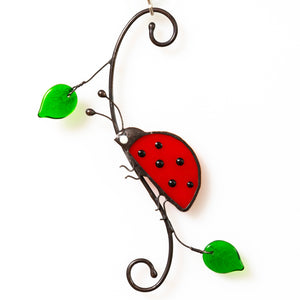 Stained glass ladybug with leaves side view suncatcher