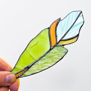 Stained glass window hanging of a green feather