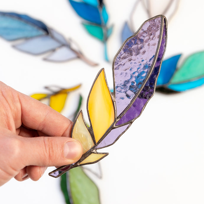 Stained glass purple feather with yellow parts suncatcher