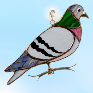 Stained glass pigeon sitting on the branch suncatcher
