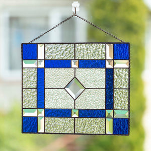 Stained glass clear and cobalt panel with beveled inserts for window